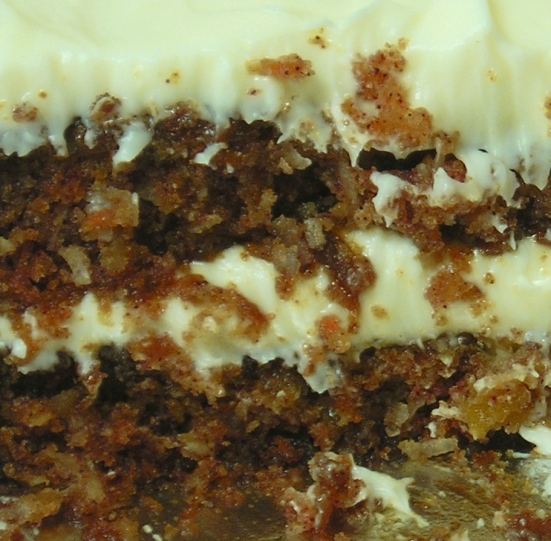 "Ahh, a close-up of the winningly moist texture of this cake! A few days after the dinner party, I made 2 dozen carrot cupcakes for Mom's best friend's birthday. With the leftover batter, I made this two-layered 9"" cake - not to be confused with the three-layered behemoth from the dinner party."